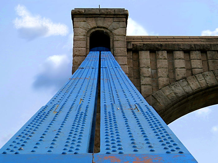 Architectural Feature Architecture Blue Bridge Detail Diminishing Perspective Low Angle View Metal Structure No People Outdoors Pillar Tall - High View From Below Minimalist Architecture