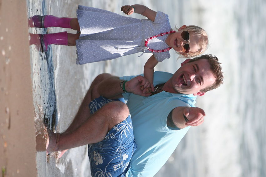 daddy's daughter in fashion design, clothes pose like model together to photo sesion, mother run over the water 20 Years Old Dady Active Blond Long Hairs Blue Dress In Flowers Blue Polo T-shirt Blue Swimsuit Daddy's Girl Emocions Fashion Fashionably Glamorous Modeling Mother & Daughter Mother Run In Water Photosesion Pink Color Corals, Pearls Pink Wellies Pose Poser Small Girl Smile Sunglasses Wellington