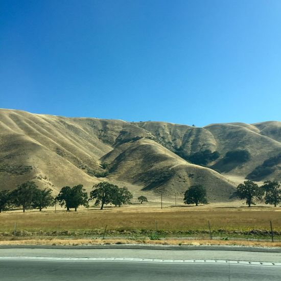 Scenery along I-5 California. Landscape Road Day Clear Sky Nature Tranquility Tranquil Scene Blue Mountain Outdoors Scenics Beauty In Nature Transportation Arid Climate Desert No People Mountain Range Tree Sky Horizon Over Land