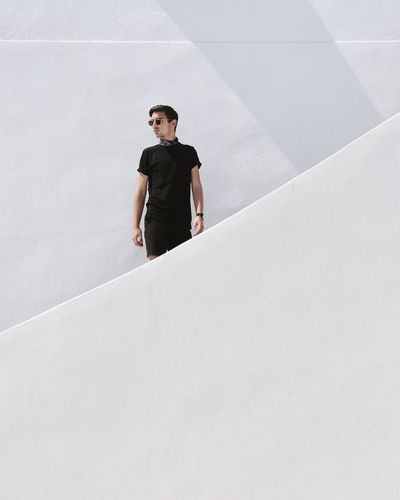 EyeEm Selects Young Adult One Person Standing Architecture Outdoors Cyclades Architecture Arch Minimalism Minimalist Architecture Santorini Santorini, Greece Greece EyeEm Best Shots Eye4photography  TheWeekOnEyeEM The Week Of Eyeem The Week On EyeEm Geometry Shadow White Whitewashed Fashion Architecture_collection Fresh On Market 2017