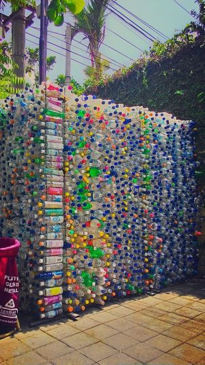 Keep Clean for Healthy planet Plastic Plastic Environment - LIMEX IMAGINE Bottle Plastic Bottles Garbage Cleaning Environment Environmental Conservation Earth Clean Earth Multi Colored Water Sky Chainlink Fence Street Art Colorful