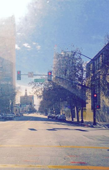 City in Spring Urban Spring Fever Buildings Road Sky Windshield Trees Blue Wave