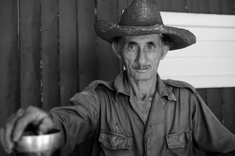 Very nice and welcoming coffee farmer in Cuba, who allowed me to take his portrait and share it with the world - he works day and night on a coffee and tobacco plantation near Viñales Coffee Farm Cuba Farm Farmer Havana Man Travel Trinidad Viñales Authentic Black And White Cuban Cubano Face person Portrait Tourism The Portraitist - 2018 EyeEm Awards The Traveler - 2018 EyeEm Awards