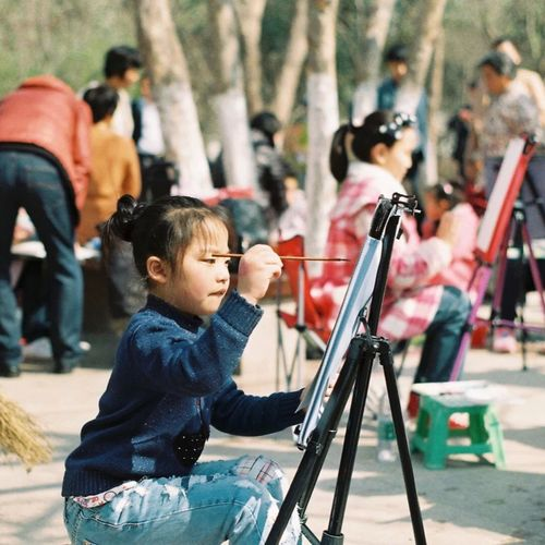 A little girl is drawing in the park Check This Out That Girl City Life Lovely Day