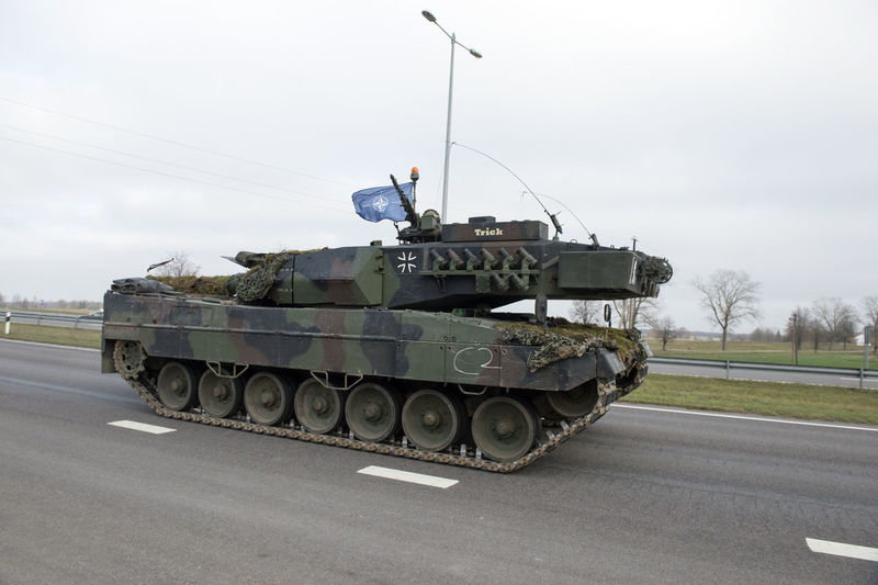 Leopard2 Tank Transportation Road Mode Of Transportation Sky Land Vehicle Day Military Army Armored Tank Armed Forces Nature Real People Street One Person Outdoors Men Government Sign City Lithuania Lietuva