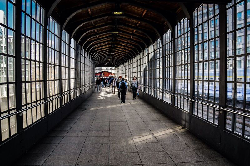 People on walkway at berlin friedrichstrasse station