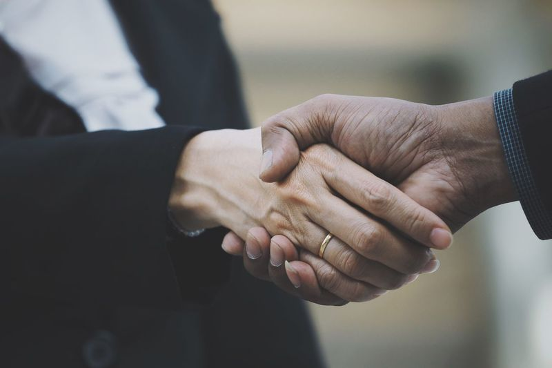 Human Hand Togetherness Handshake Agreement Two People Teamwork Bonding Holding Hands Partnership - Teamwork Unity Real People Friendship Connection Women Men Day Greeting