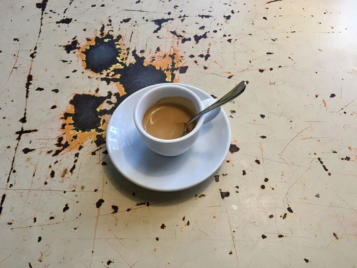 High Angle View Of Espresso On Table
