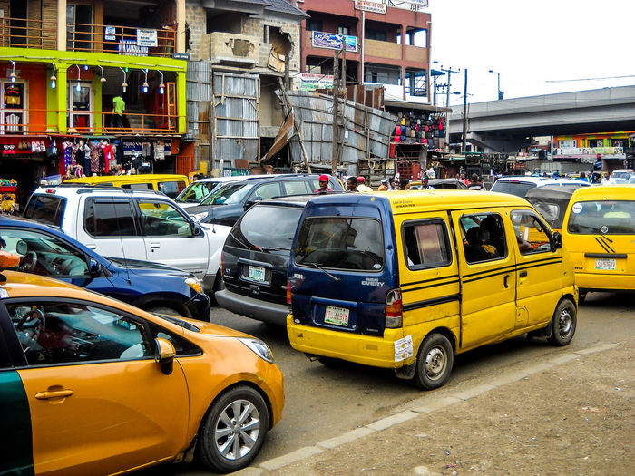 Busy streets and traffic. Lagos, Nigeria. Lagos Nigeria Busy Streets And Traffic Streetphotography People EyeEm Awards 2018 The Street Photographer - 2018 EyeEm Awards City Yellow Taxi Car Taxi Architecture Building Exterior Sky Built Structure Bus Vehicle Traffic Jam Traffic Rush Hour