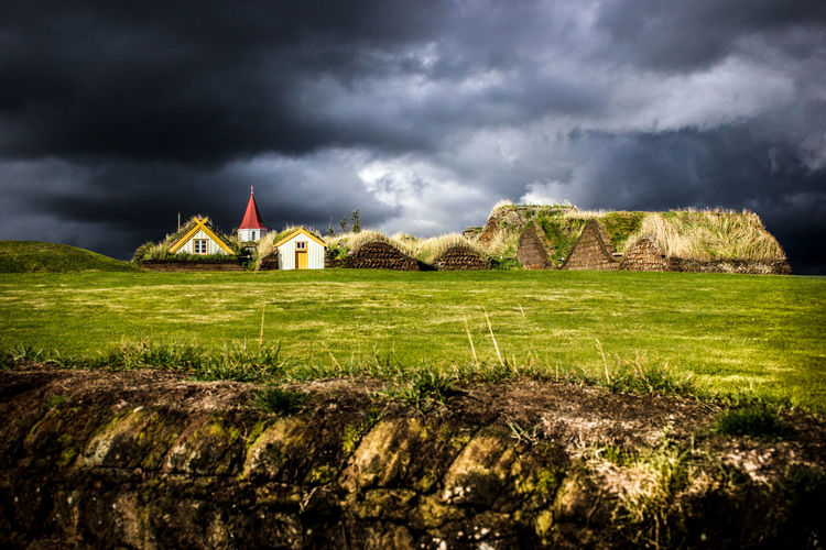 Bad Weather Church Cloudy Dark Skies Historical Building Iceland Black Clouds Black Sky Fence Grassland Historic Village Museum Outdoors Rainclouds Rough Weather Storm Cloud Sun And Clouds Tiny House  Traditional Building Turf Turf Divots Turf Houses Turf, Sod; Lawn, Green The Great Outdoors - 2018 EyeEm Awards