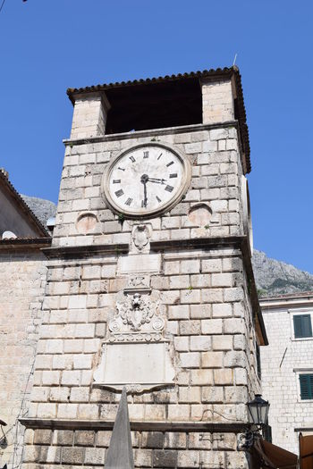 Kotor Montenegro Architecture Building Building Exterior Built Structure Clear Sky Clock Clock Face Clock Tower Clocktower Day Kotor Old Town Low Angle View Minute Hand Montenegro Nature No People Old Outdoors Roman Numeral Sky Time Tower Wall Wall - Building Feature