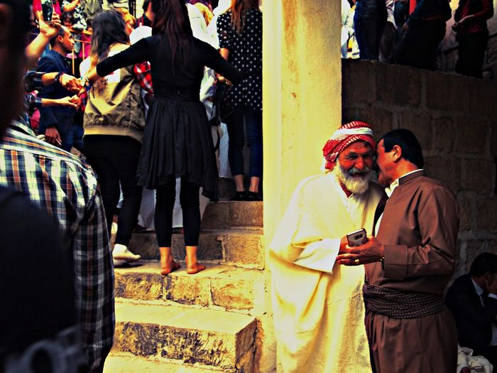 Men talking and sharing a joke Celebration Culture Event Iraq Kurdistan Large Group Of People Men Middle East Outdoors Real People Yezidi The Photojournalist - 2017 EyeEm Awards