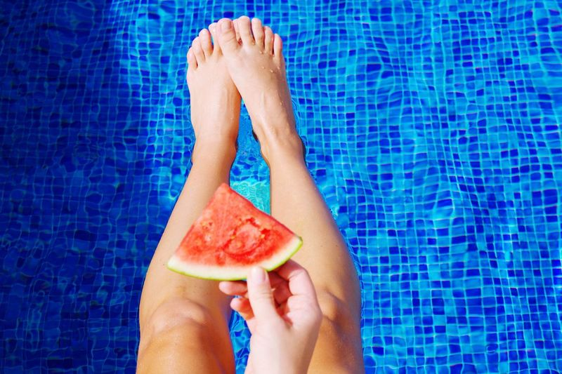 Eating watermelon by the pool Summer Food Watermelon Human Body Part Wellbeing Swimming Pool Pool One Person Food And Drink Blue Healthy Eating Lifestyles Freshness Healthy Lifestyle