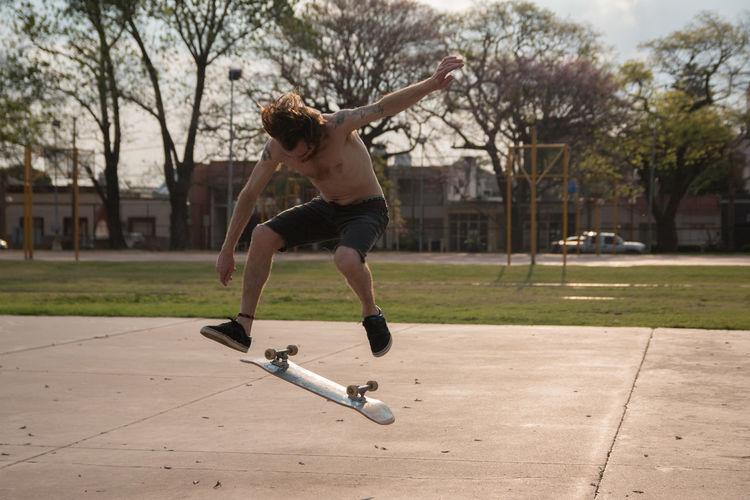 Full length of man skateboarding