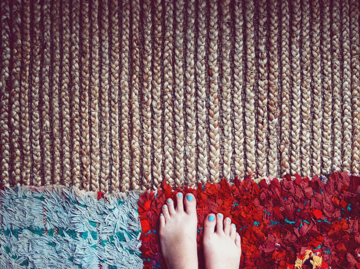 Low Section Of Woman On Rug