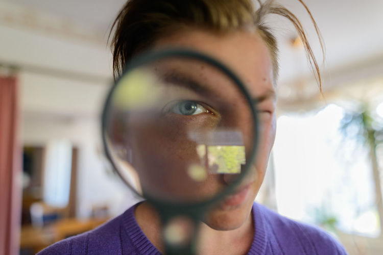 Close-up portrait of man holding camera