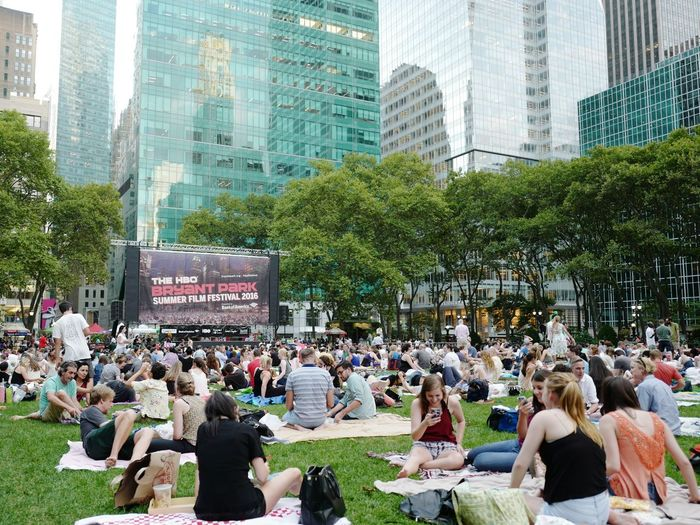 """Waiting for """"The Big Chill"""", Bryant Park Summer Film Festival, August 2016 Bpfilmfest Bryant Park  Film Festival Outdoor Movie Cinema Outdoor Cinema Outdoor Cinema Projection Bryantpark Filmfeed Streetphoto_color Leicaq Streetphotography Street Photography Midtown Manhattan NYC"""