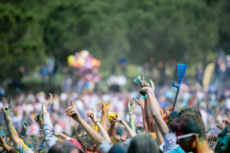 People with arms raised during holi