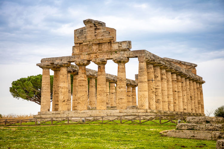 Italy Paestum History The Past Ancient Sky Architecture Built Structure Old Ruin Cloud - Sky Ancient Civilization Travel Destinations Nature Architectural Column Travel Old Day Tourism Ruined Damaged Grass Archaeology No People Outdoors Deterioration