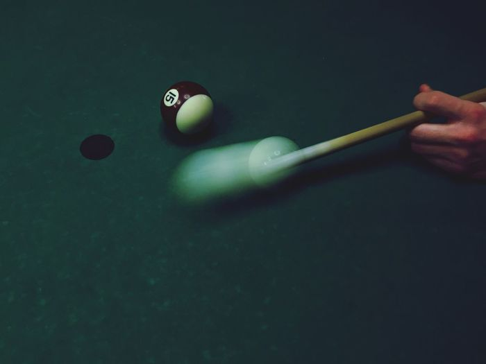 High angle view of hand playing pool