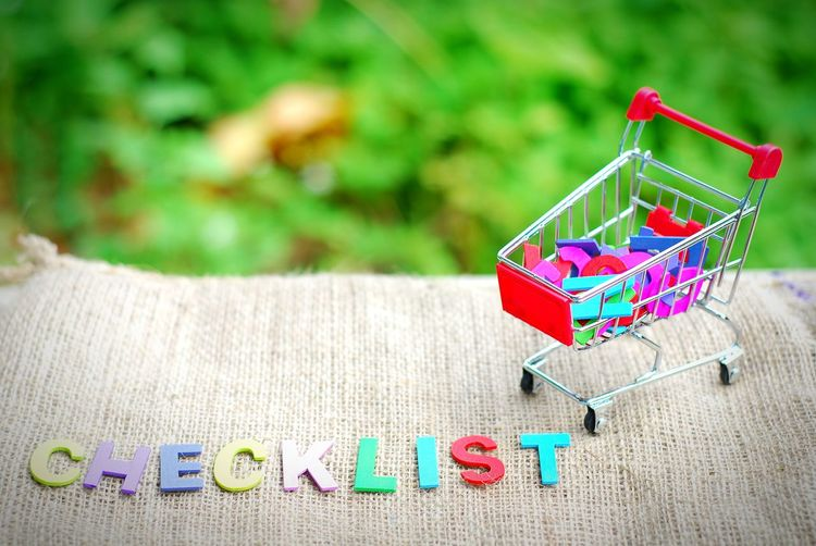 Colorful checklist text by shopping cart toy