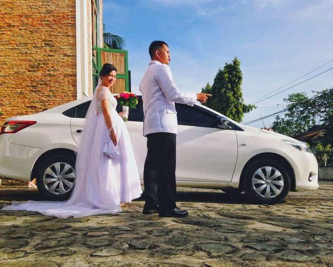Car Transportation Standing Full Length Mode Of Transport Sky Outdoors Wedding Dress Young Women Young Adult Love Bride Land Vehicle Women Day Togetherness Wife Two People Wedding Wedding Photography Weddings Around The World Eyeem Philippines