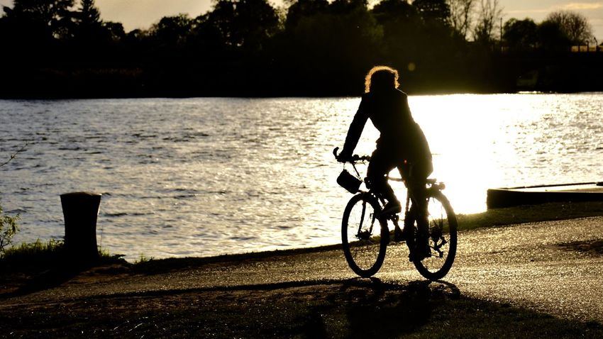 Enjoy the sunset at the water 3XSPUnity Adventure Beauty In Nature Bicycle Day EyeEm Best Shots Full Length Leisure Activity Lifestyles Men Mode Of Transport Nature One Person Outdoors People Real People Sea Silhouette Sky Sunlight Sunset Sunset Silhouettes Transportation Tree Water