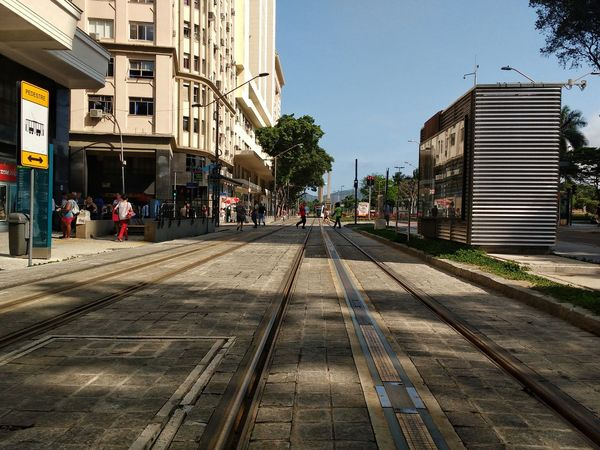 The new tram line in the city centre of Rio. City City Architecture Building Exterior Street Outdoors Tree Built Structure Day People Adult Adults Only Editorial  Unedited Brazilian Tram Vlt Cinelândia  Downtown City Centre City Tram Line Tram Tracks Afternoon Life