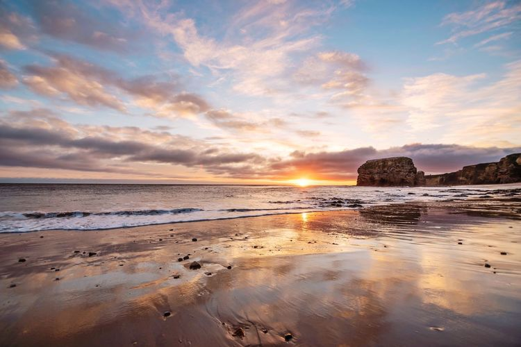 Marsden beach Reflection Nikon Nikonphotography EyeEm Masterclass Photooftheday Sea Water Beach Land Sky Scenics - Nature Beauty In Nature Outdoors Non-urban Scene No People Low Tide Horizon Idyllic Nature Sunset Sand Tranquil Scene Horizon Over Water Tranquility Cloud - Sky