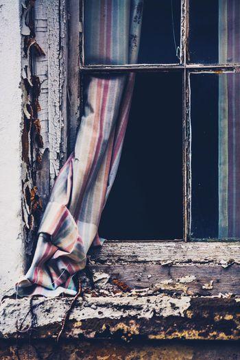Broken window of abandoned house