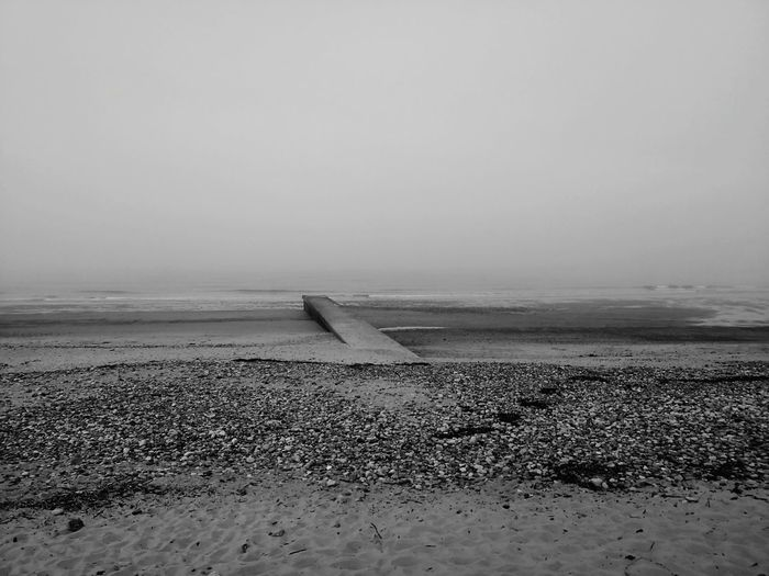 Through the fog and across the sea, there is a whole world to discover North Sea Pier Beachphotography Huawei Mate 10 Pro Black And White Black And White 4 Filter Foggy Foggy Weather Landscape Blyth Waters Edge Northumberland Water Low Tide Sea Beach Sand Horizon Over Water Pebble Beach Coastal Feature Coastline Ocean Calm Seascape Coast Tide Pebble FootPrint #FREIHEITBERLIN