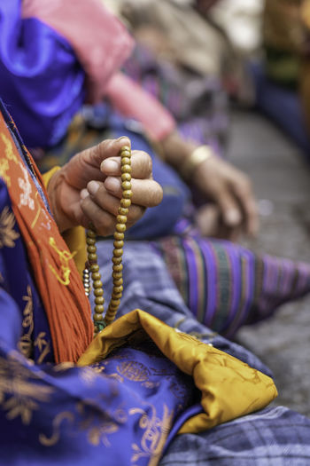 Close-up of hand holding prayer beads
