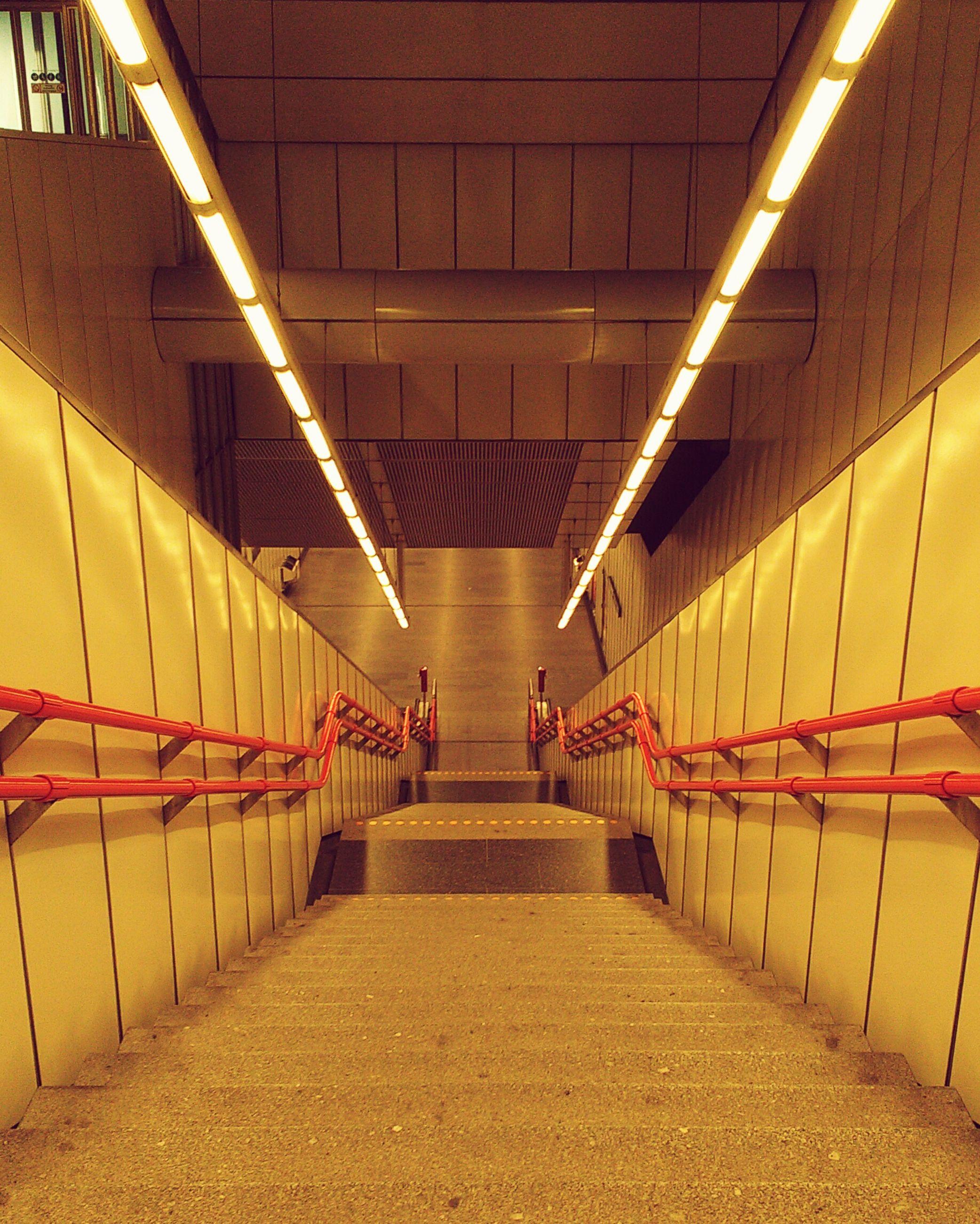 illuminated, indoors, lighting equipment, modern, ceiling, architecture, escalator, long, tunnel, subway station, the way forward, railing, narrow, city life, pedestrian walkway, electric light, underpass, convenience, diminishing perspective, fluorescent light, underground walkway, subway platform