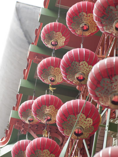 Low angle view of red lanterns hanging for sale in market