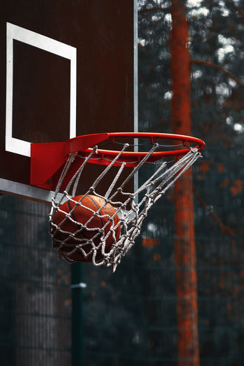 Close-up of basketball in hoop