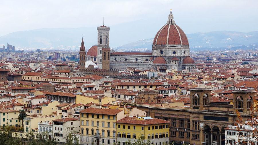 Duomo santa maria del fiore amidst cityscape against sky