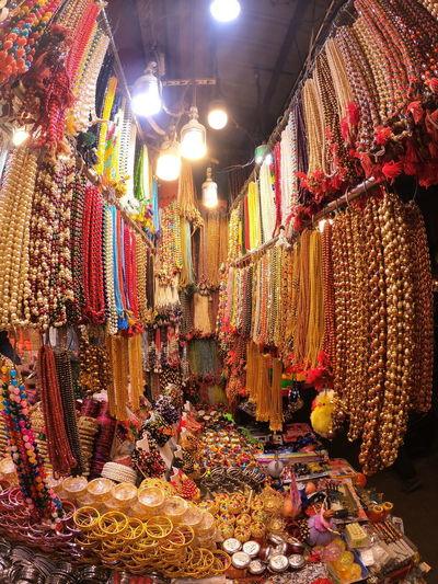 Illuminated chandelier at market stall