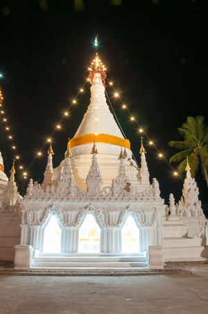 Architecture Arrival Building Feature Built Structure Business Finance And Industry Celebration Christmas Christmas Tree City Gold Gold Colored Night No People Outdoors Pagoda Phrathatdoikongmoo Place Of Worship Religion Statue Tradition Travel Destinations Tree Waving