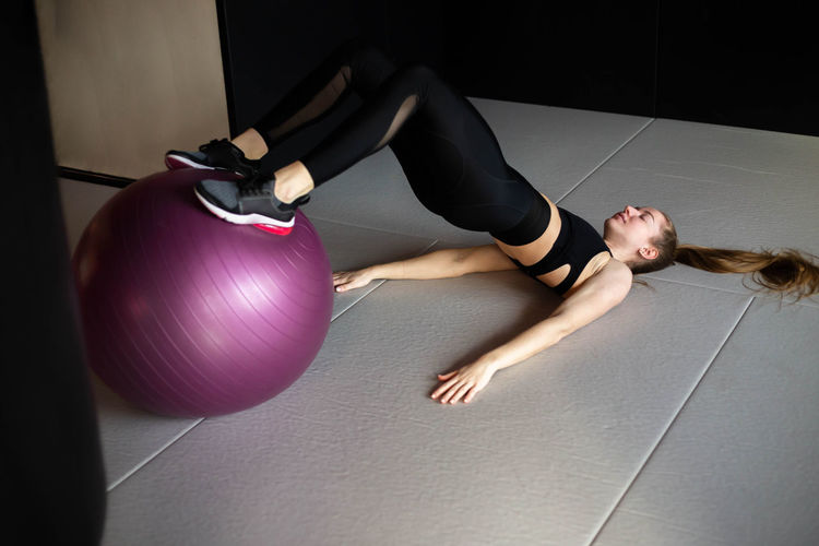 Midsection of woman relaxing on floor