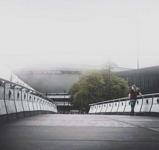 Railing Bridge - Man Made Structure One Person Connection Full Length Architecture Built Structure Exercising Lifestyles Day Leisure Activity Men Outdoors Fog Real People Standing Healthy Lifestyle Sports Clothing Footbridge EyeEm Selects UFO The Week On Eyem Foggy EyeEm Best Edits EyeEm Gallery Your Ticket To Europe