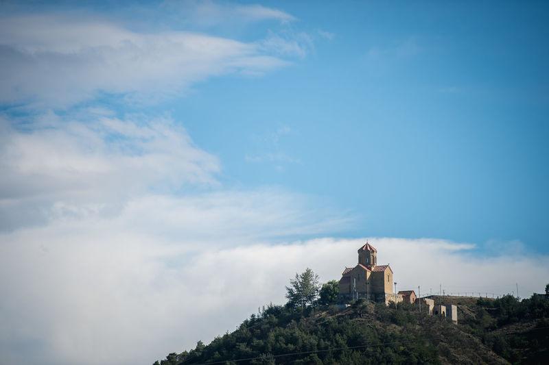 Narikala fort on hill against blue sky