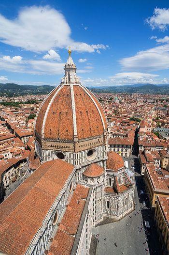 Duomo santa maria del fiore in city against sky on sunny day