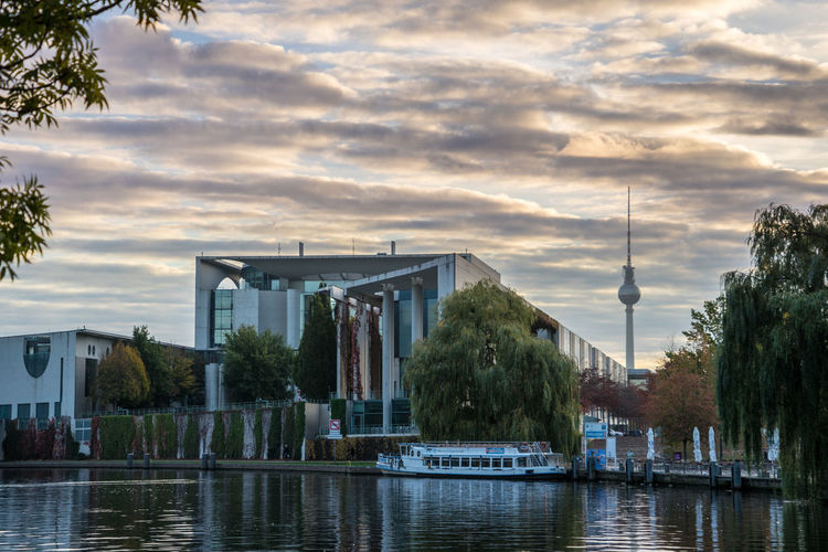 Morning walk in autumn in Berlin, Germany Built Structure Sky Architecture Water Cloud - Sky Building Exterior Tree Plant Nature Waterfront Reflection Building City Sunset River Transportation No People Outdoors Day Autumn Leaves Morning Sunrise