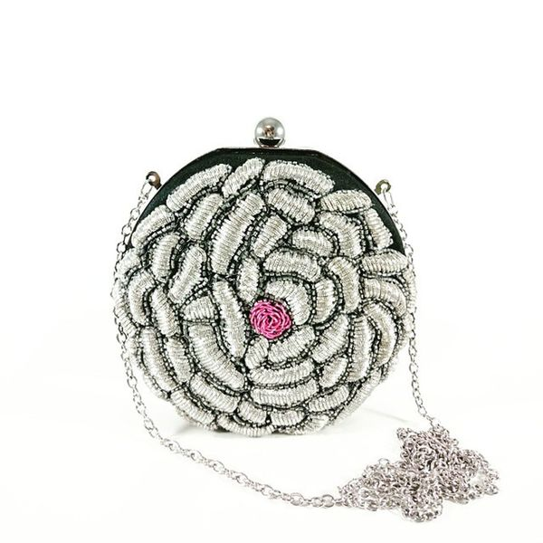 Check out Silver flower clutch bag from our latest collection at www.desiroyale.com Clutch Clutchbag Desi Desiroyale