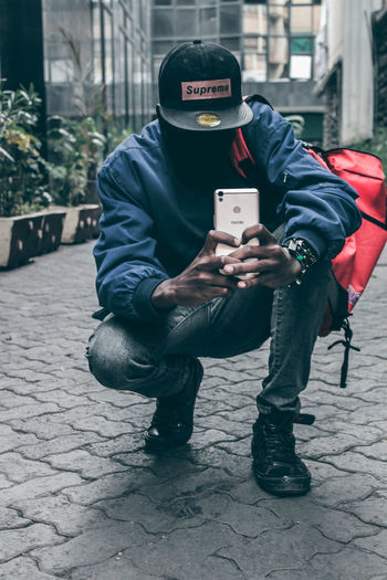 Phone camera challenge Africa Fresh On Eyeem  Teenager Fashion EyeEm EyeEm Best Shots Moody Fresh On EyeEm 2018 PhonePhotography One Man Only Only Men One Person Adult Adults Only Men Full Length Outdoors City Day Warm Clothing