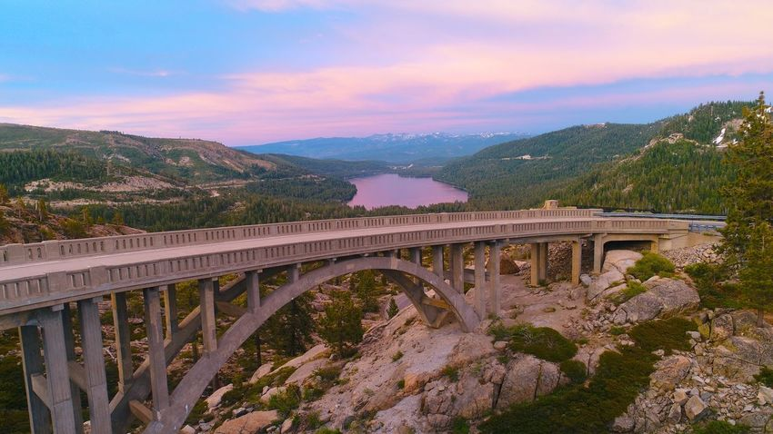 """""""Keep close to Nature's heart... and break clear away, once in a while, and climb a mountain or spend a week in the woods. Wash your spirit clean."""" Mountain Nature Bridge Laketahoe Truckee  California Landscape Lake Mountain Range Outdoors Johnmuir Drone  Canonphotography Dji USA Sunset Forest First Eyeem Photo Letsgotogether Letsgo Together Eyemphotography Eyem Best Shots Eyemnaturelover Eyem Best Shots Nature_collection"""