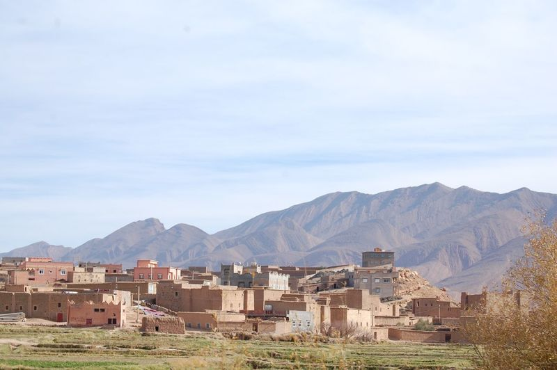 View of buildings against mountains
