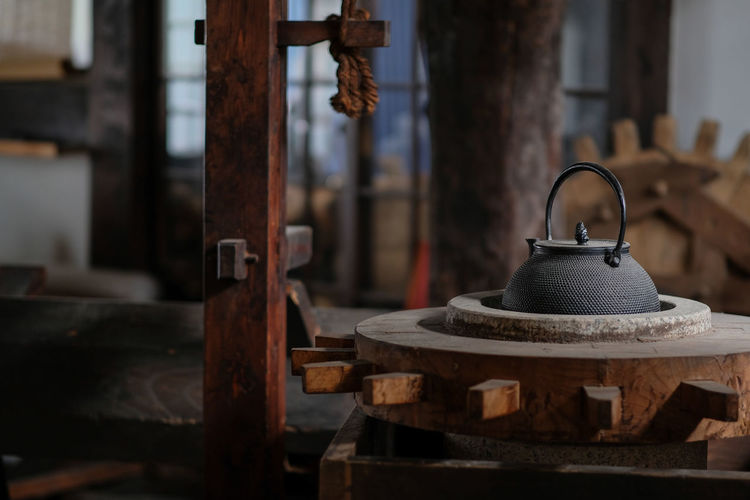 Close-up Day Focus On Foreground Gear Iron Pot No People Old Selective Focus Still Life Watermill Watermill Coffee Shop Waterway Wood - Material Wood Gea Wooden