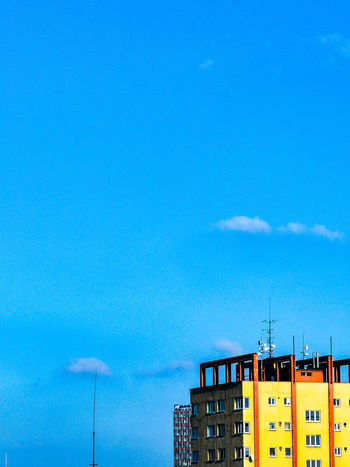 Architectural Feature Architecture Blue Building Exterior Buildings & Sky Built Structure City Cityexplorer Contrast Day Low Angle View Minimal Minimalism Minimalist Minimalist Architecture Minimalobsession No People Outdoors Simplicity Sky Urban Urban Photography Paint The Town Yellow
