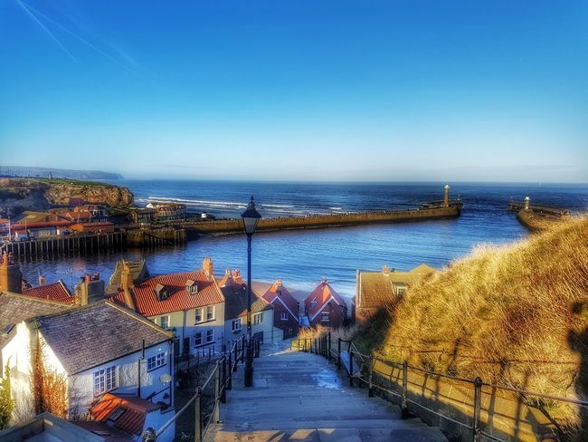 Whitby, North Yorkshire Whitby Seeside Sea Water Clear Sky Outdoors Travel Destinations Day Sky Tranquility Nature Harbor Horizon Over Water Beauty In Nature Architecture Scenics Cloud - Sky No People Built Structure Dramatic Sky